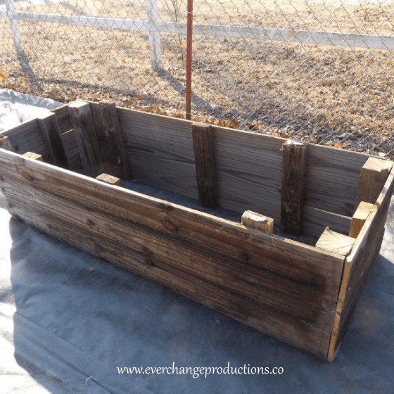 These raised beds are made from old fence wood. Start your garden with whatever you have lying around!