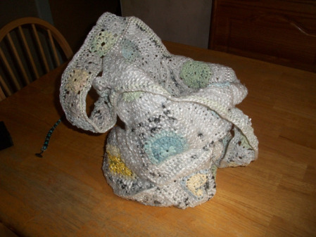 My inspiration to learn how to make plarn (plastic yarn) and crochet is this bag my grandmother gave me.