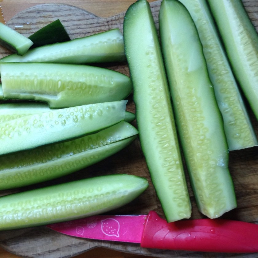 Cut fresh cucumbers into spears.