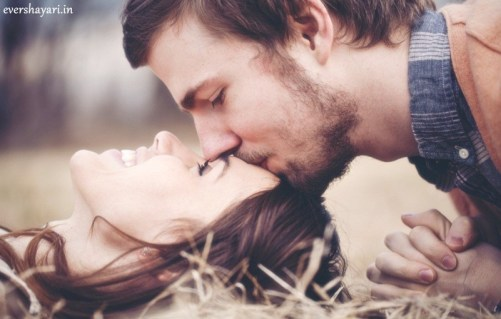 Romantic couple boy kiss on girl forehead