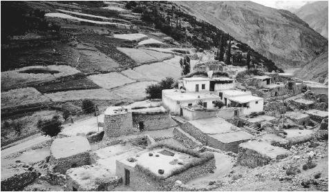 Houses in Baltit. Pakistan's landscape includes snowcapped mountains and valleys such as this, as well as sunny beaches.