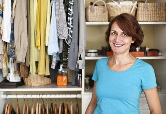 woman-standing-in-front-of-organized-closet