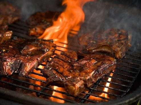 sizzling steaks on the grill