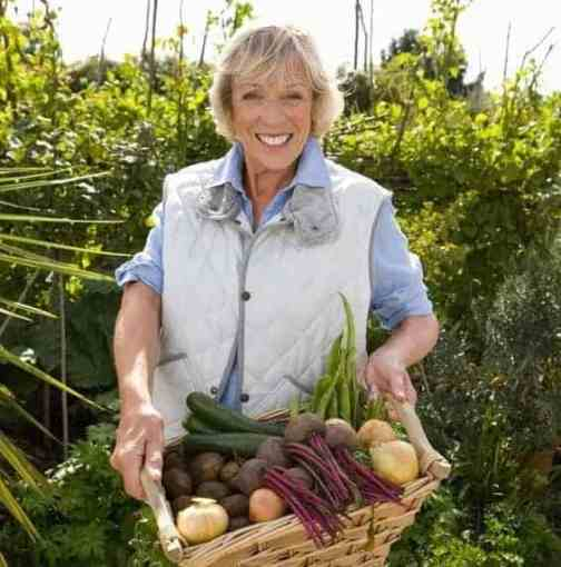 woman-with-basket-beets-beans-smiling-portrait