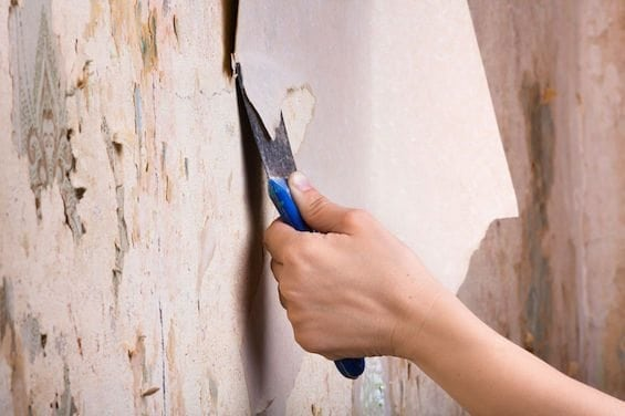 39382614 - removal of old wallpapers with spatula