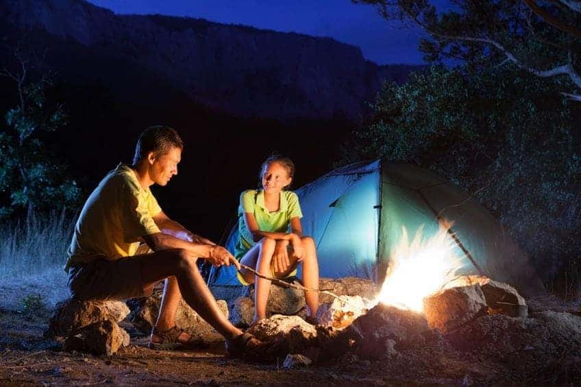 campfire-camping-couple-night