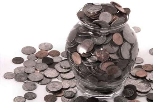 A Jar of Coins Full and Running Over