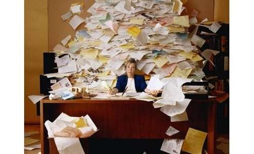 woman-at-desk-buried-in-mail