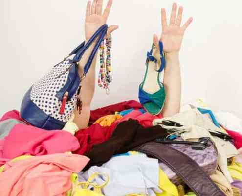 Woman buried in cluttered closet.