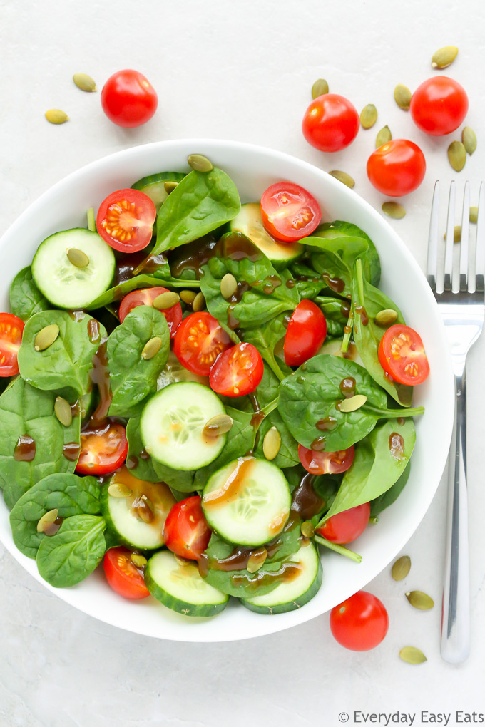 Cherry Tomato & Spinach Salad - A quick, super healthy salad dressed with a delectable honey balsamic vinaigrette. | EverydayEasyEats.com