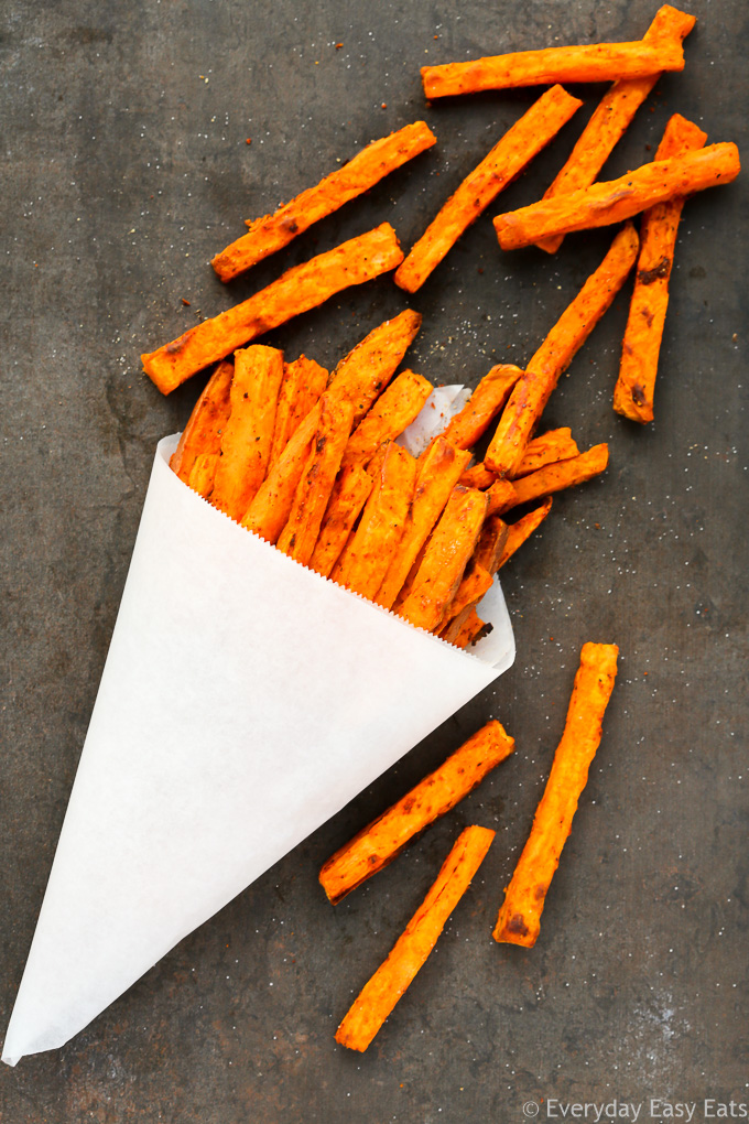 Spicy Baked Sweet Potato Fries - A tasty side, appetizer, or snack that is paleo, vegan and so simple to make! | EverydayEasyEats.com