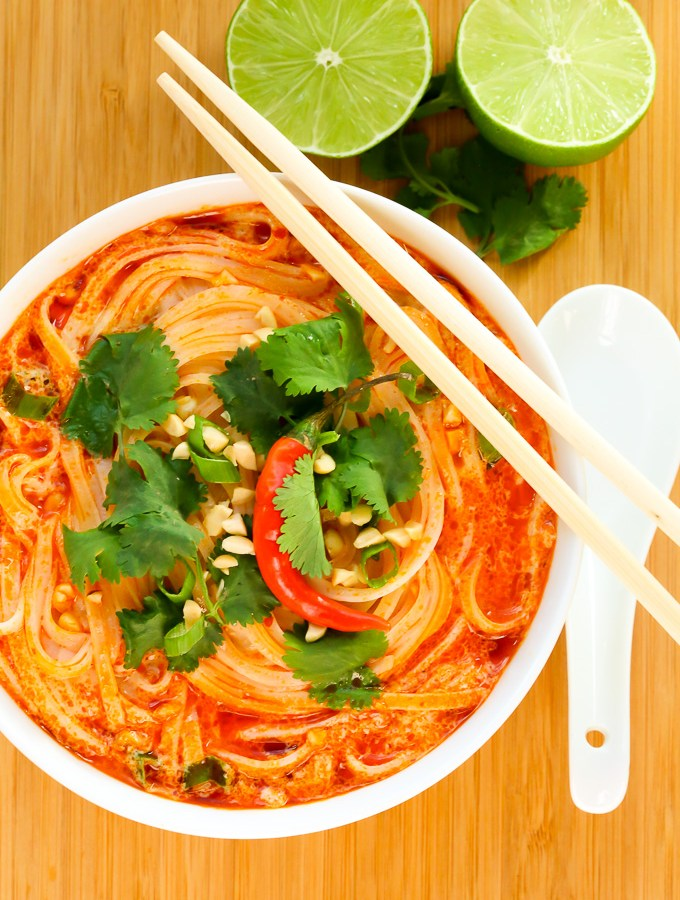 Overhead view of Thai Spicy Noodle Soup in a white bowl with chopsticks