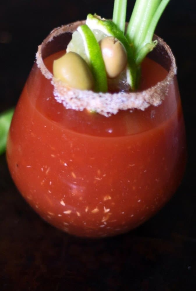 A thirst quencher of a cocktail, the perfect Bloody Mary with a twist of lime, olives and celery.