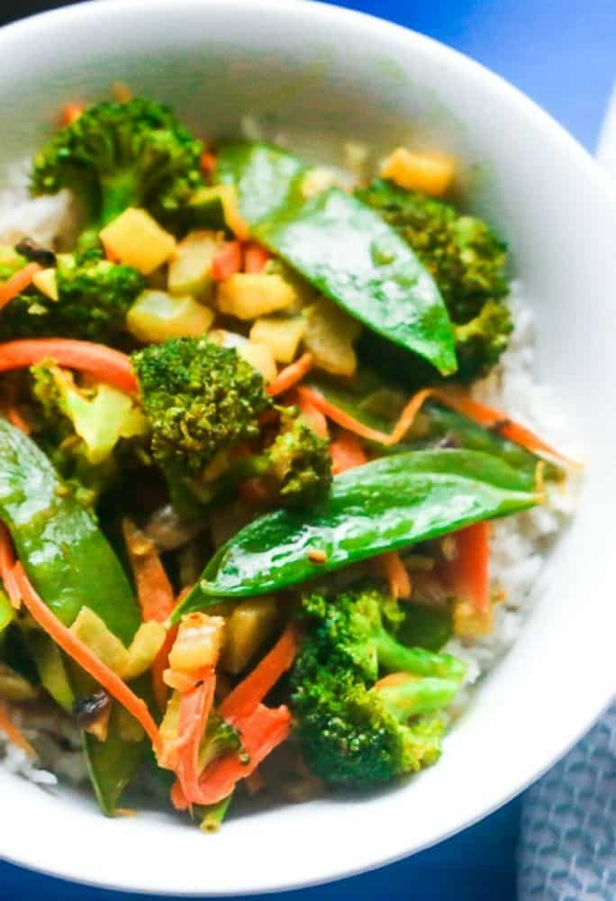 Delicious coconut infused vegetables and rice with garlic and curry