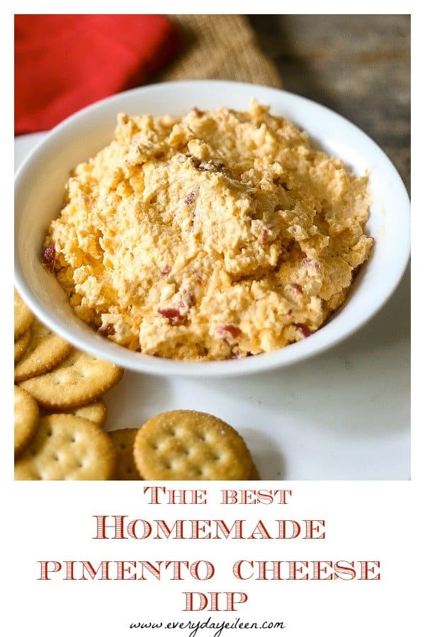 Delicious homemade pimento cheese dip party ready in a white dip bowl and crackers in the base of the bowl.