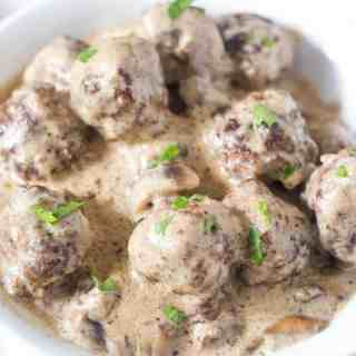 Swedish Meatballs in gravy made in the Instant Pot in a white bowl.