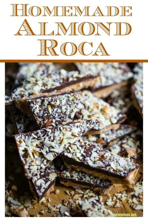 A few pieces of mouthwatering homemade almond roca piled on a cutting board