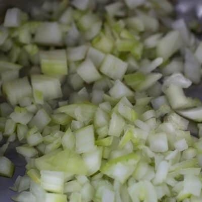 diced onions in olive oil spray in the instant pot sauteing to make chicken cacciatore.