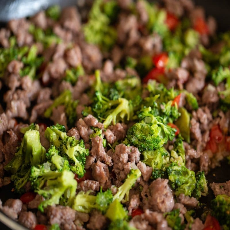 Browned crumbled sausage, broccoli, peppers, and shallots.