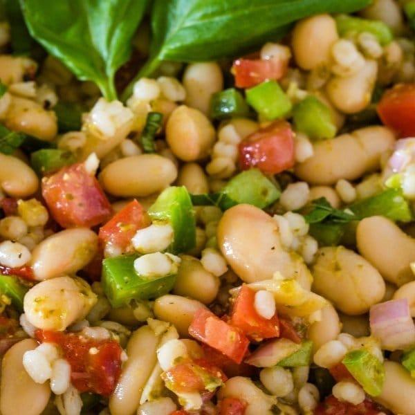Flavorful Tuscan Bean Salad garnished with fresh basil
