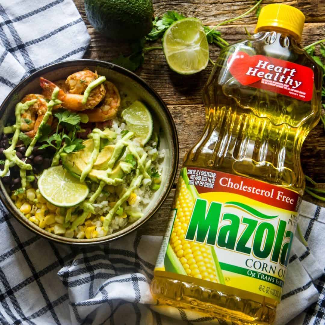 Baja shrimp taco bowl next to a large Mazola Corn Oil