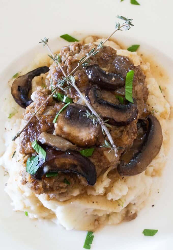 Salisbury steak with mushroom gravy over mashed potatoes