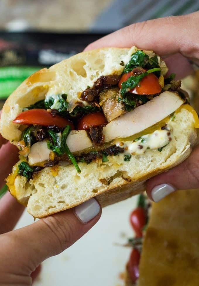 Pork sandwich topped with spinach
