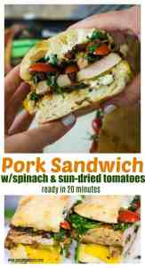 pork loin sandwich with spinach and sun-dried tomatoes being held in two hands