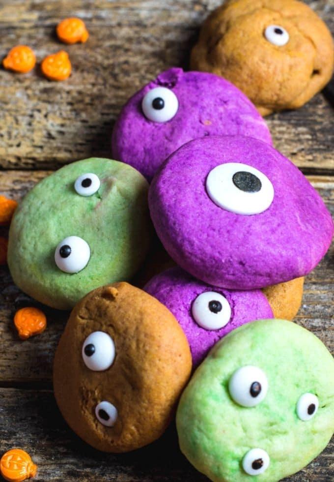 Festive monster eye cookies in purple, green, and orange.