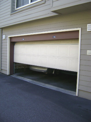 a broken garage door that needs repaired