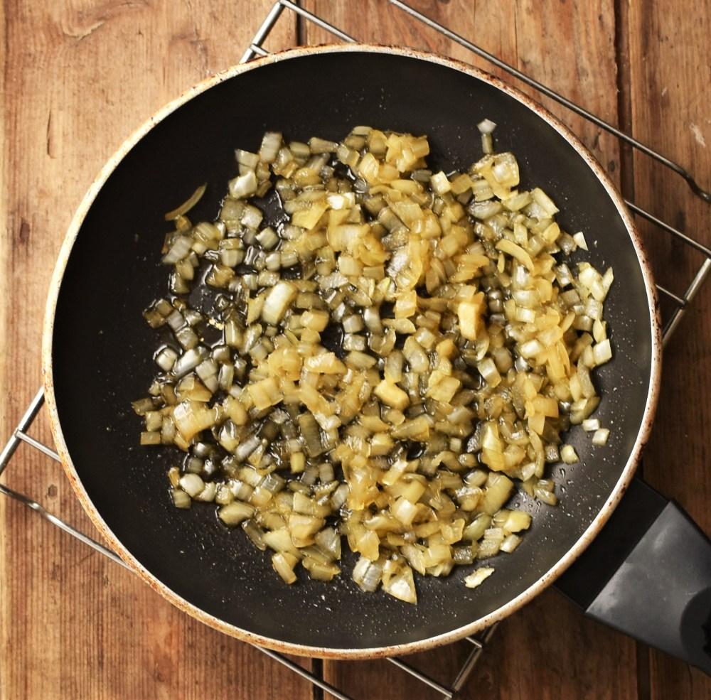 Caramelised onions in pan.