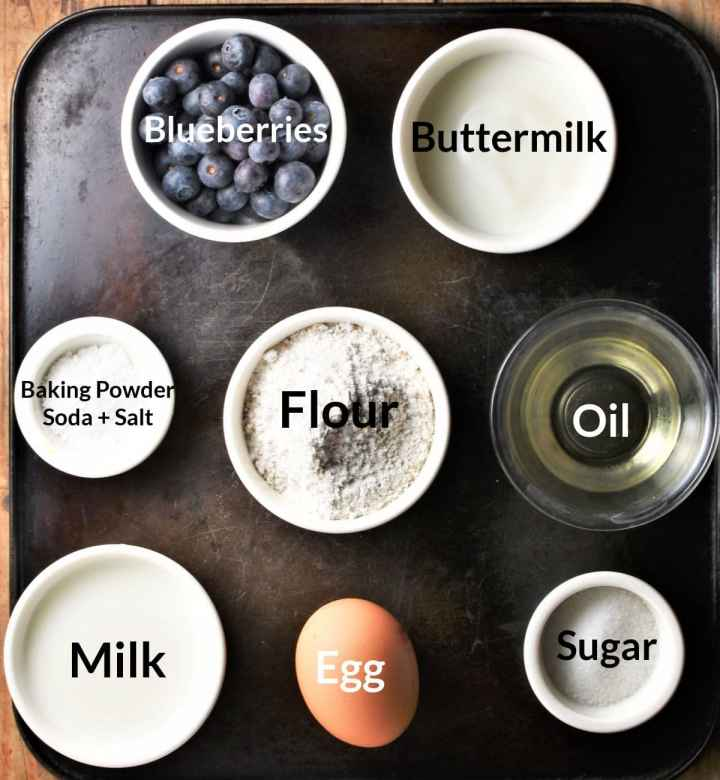 Ingredients for making healthy blueberry pancakes in individual dishes.