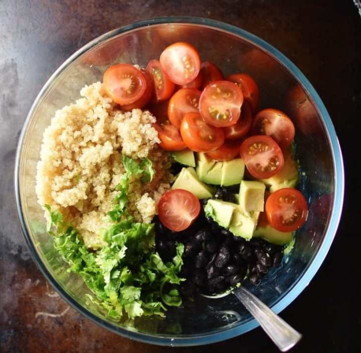 Quinoa, herbs, black beans and avocado in blender.