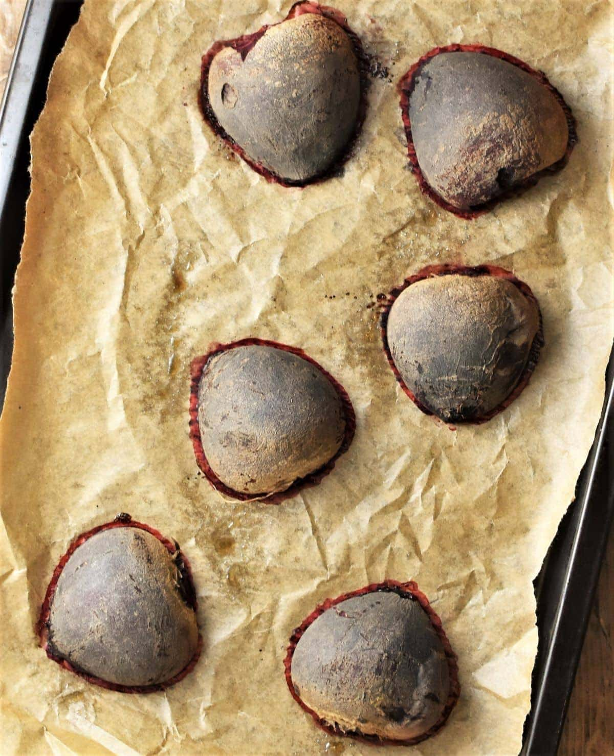 6 roasted beetroot halves on top of parchment.