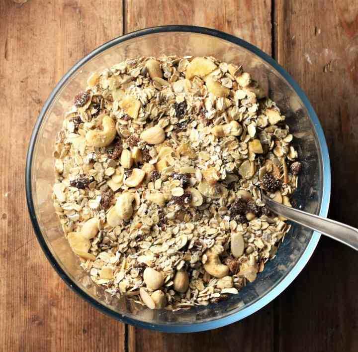 Muesli in mixing bowl with spoon.