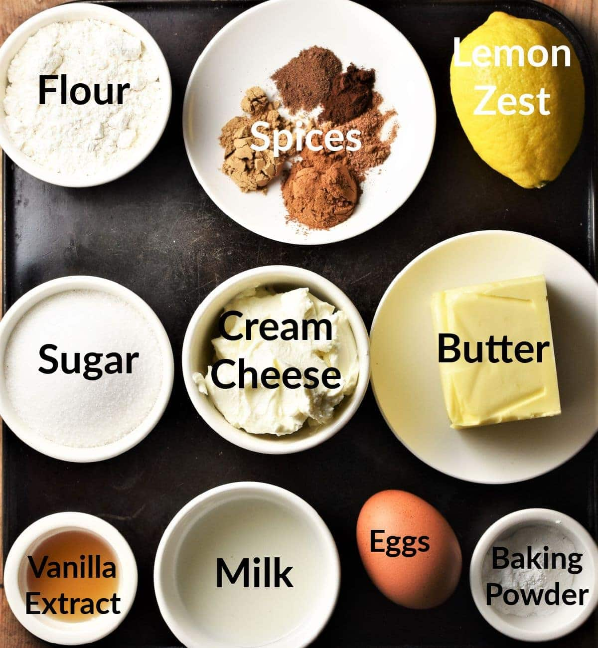 Pumpkin spice cupcakes ingredients in individual dishes.