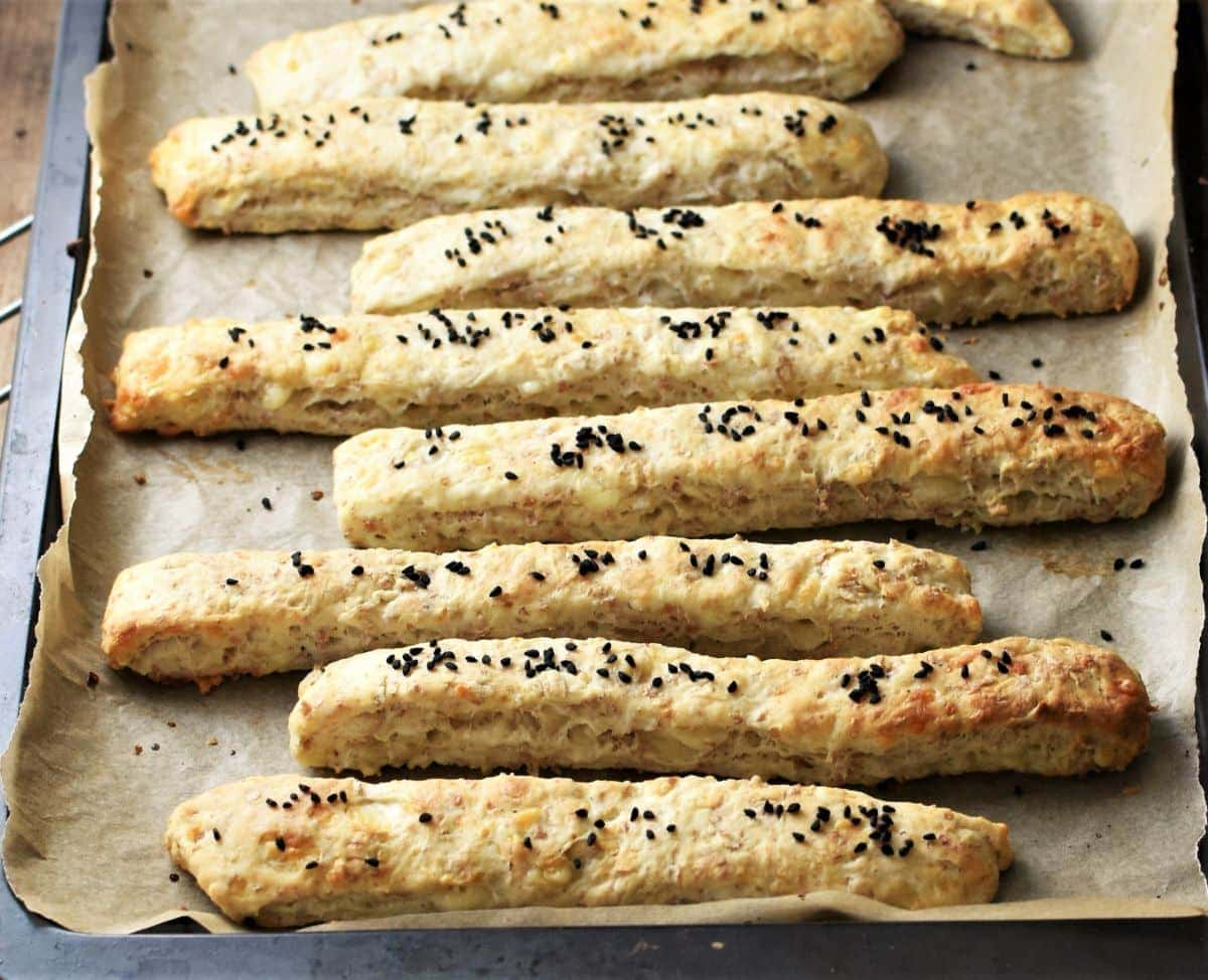 Close-up view of breadsticks on top of parchment.