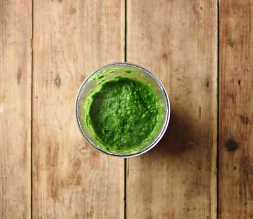 Top down view of spinach puree inside small dish.