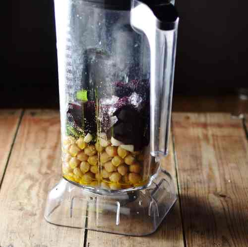 Chickpeas and chopped beets inside blender.