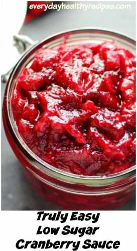 Close-up partial view of cranberry sauce inside open jar.