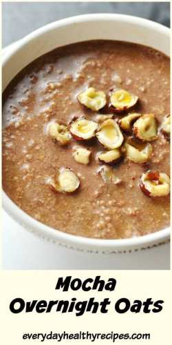 Close-up top down view of chocolate coffee overnight oats topped with crushed hazelnuts in white bowl.