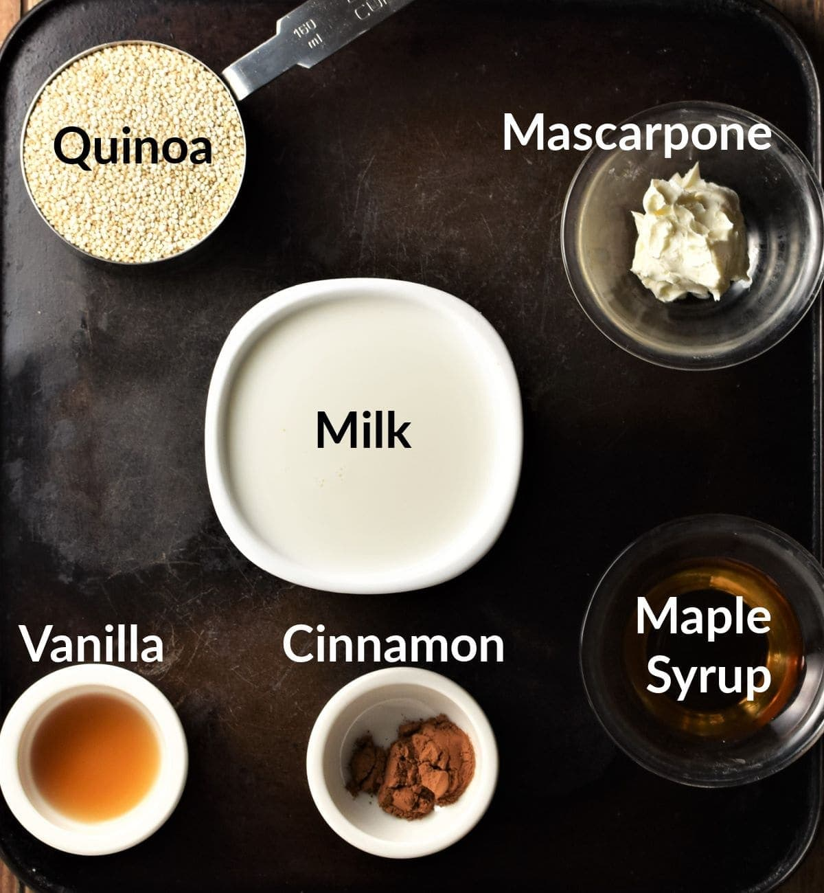 Quinoa pudding ingredients in individual dishes.