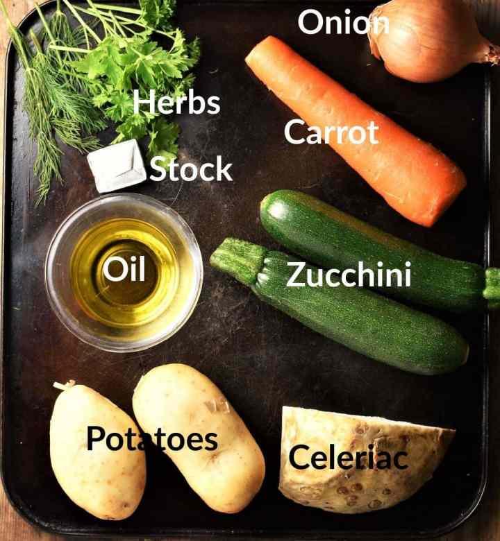 Vegetable noodle soup ingredients on top of black surface.