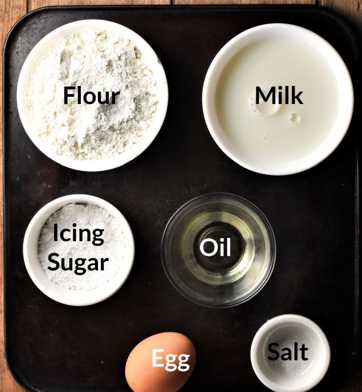 Ingredients for making Polish crepes in individual dishes.