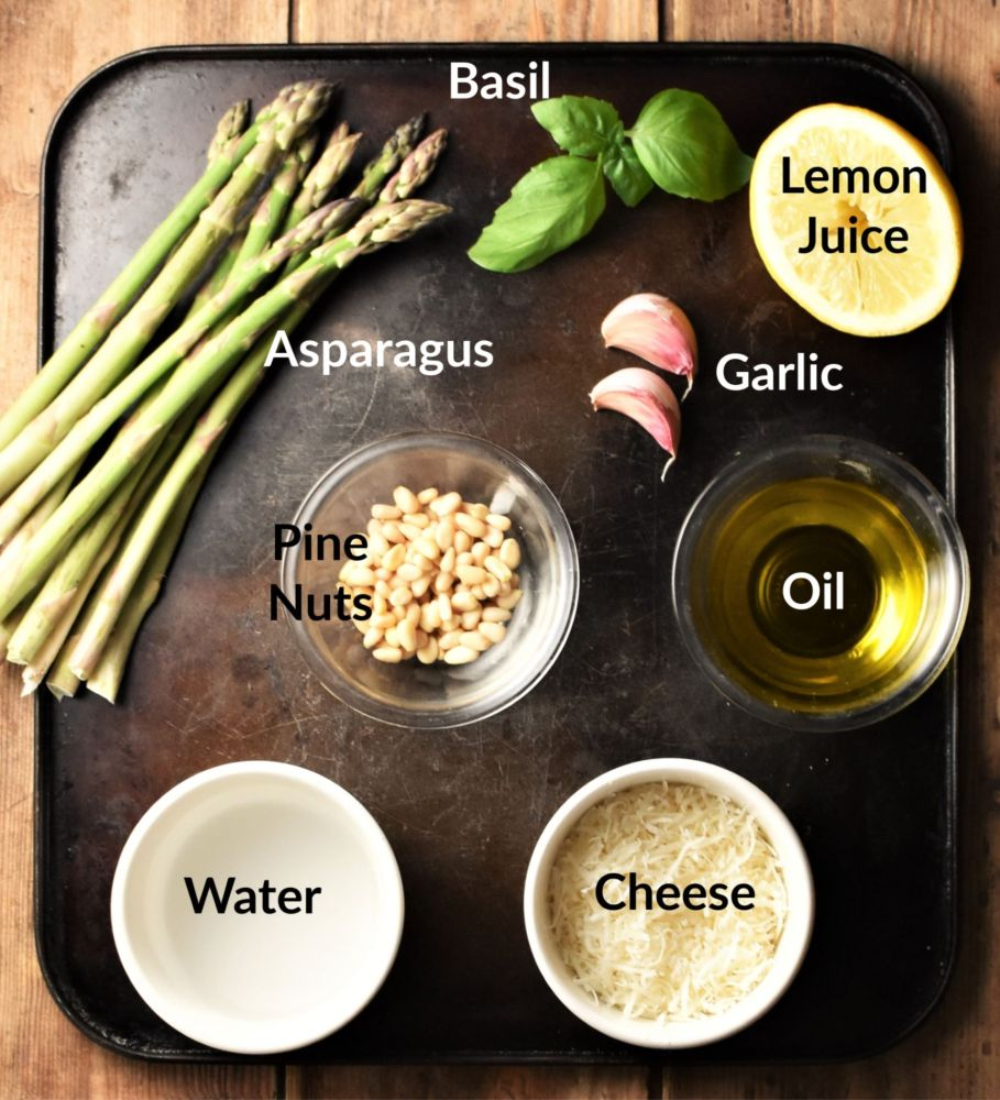 Asparagus pesto ingredients in individual dishes.