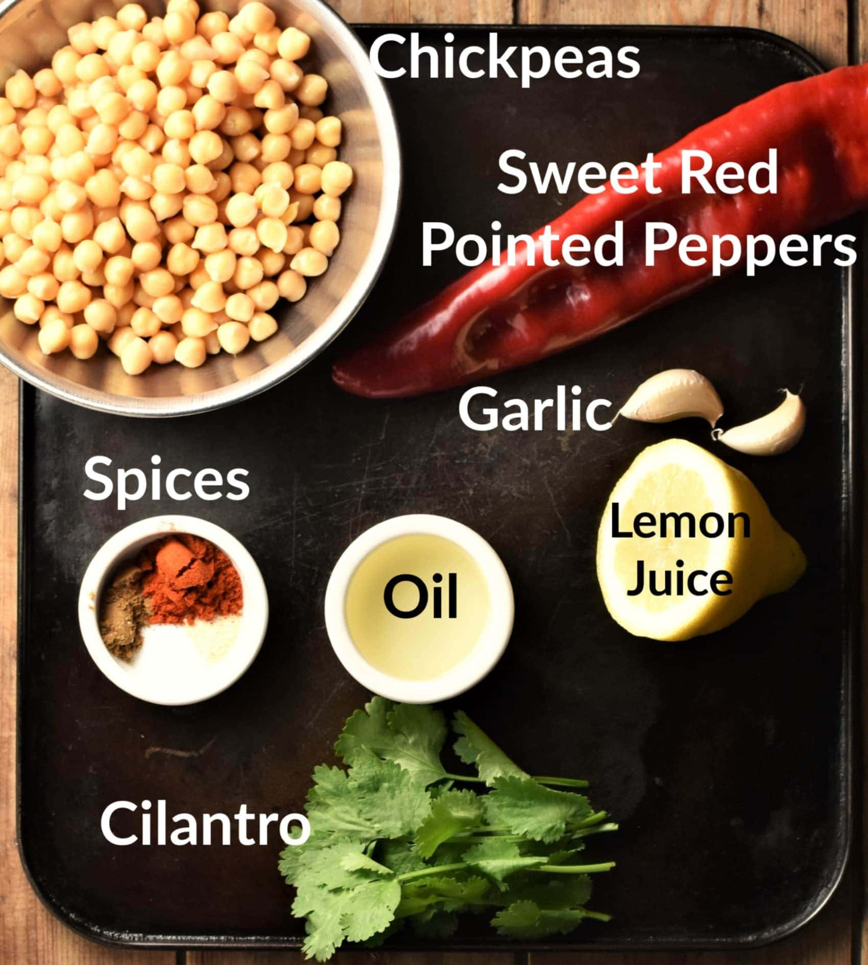 Red pepper hummus ingredients in individual dishes.