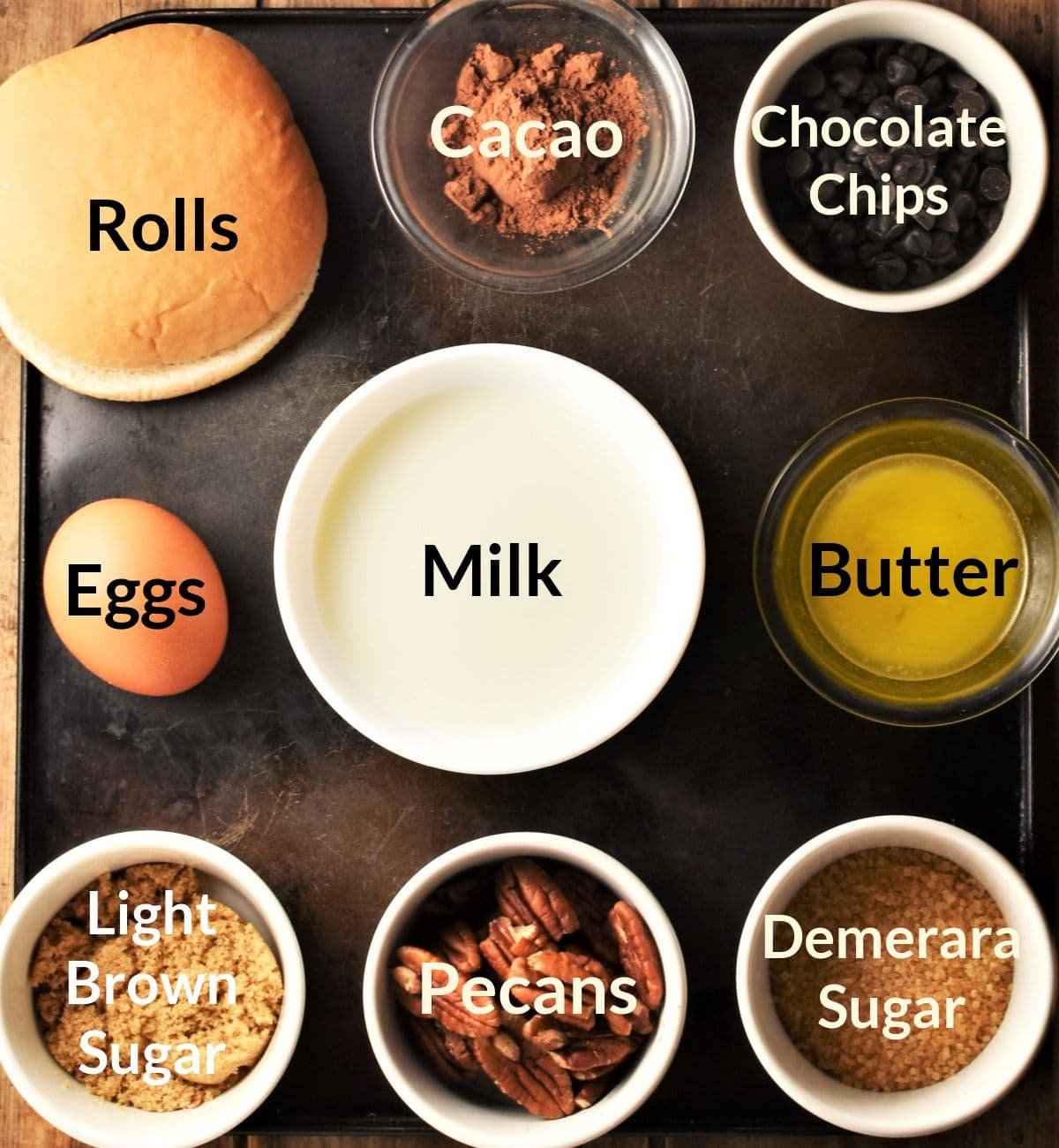 Ingredients for making chocolate french toast casserole in individual dishes.