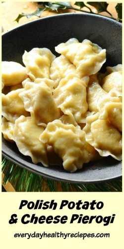Close-up view of Polish potato and cheese pierogi in black bowl.