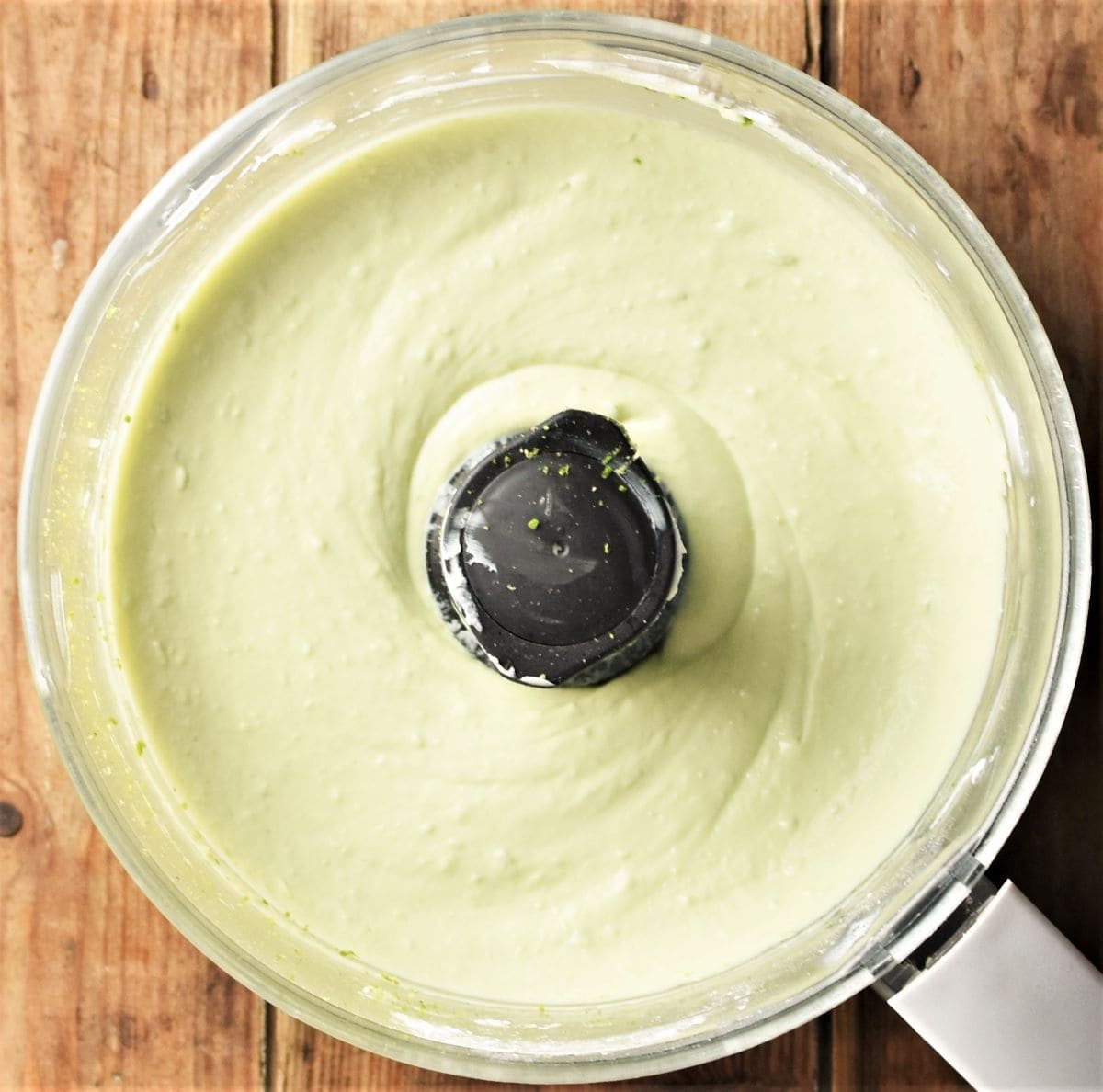 Creamy cheesecake filling mixture in blender.