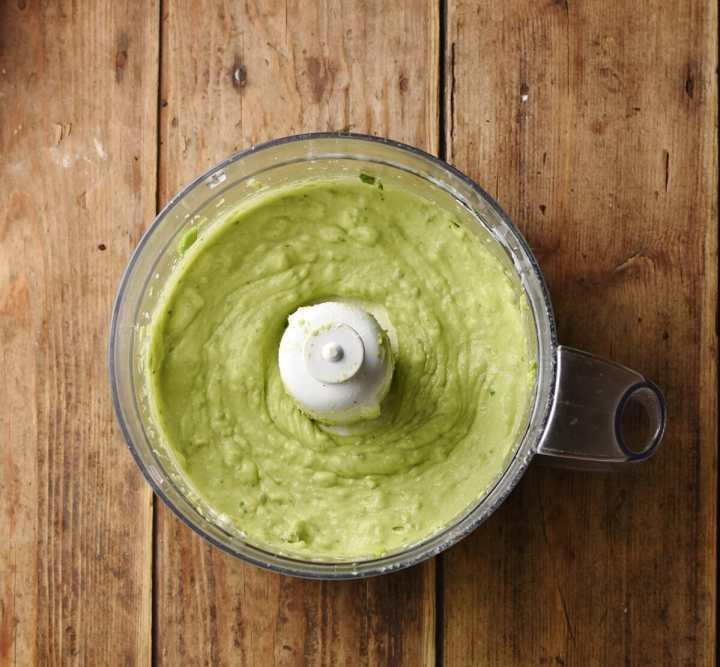 Creamy avocado mixture in blender.